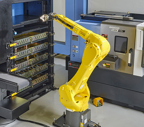 Fanuc robot with 25kg payload capability.